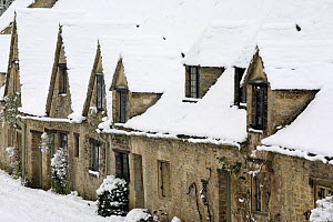Medieval cottages at Arlington Row in the winter, Bibury, The Cotswolds, Gloucestershire, England  -  Nick Turner