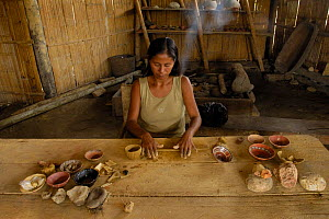 Quechua indian (Ximena Cerda) making coil ceramic bowls from clay dug out from the upper reaches of the Napo river, Ecuador, June 2005 - Pete Oxford
