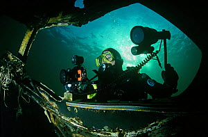 Diving photographer photographing underwater wreck  -  Alan James