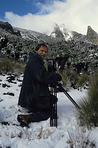 "Richard Kirby filming in deep snow on the equator on Mount Kenya for BBC NHU ""Private Life of Plants"" 1990s - NEIL NIGHTINGALE"