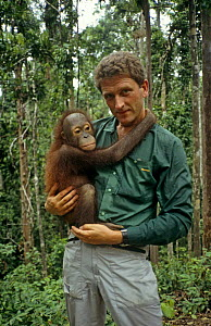 Neil Lucas (Producer and photographer) with Orang Utan, on location in Sepilok, Borneo. August 1993. - Neil Lucas