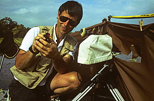 Camerman Michael Pitts with Wattled jacana (Jacana jacana) filming on location at Chagres river, Panama, filming for BBC television series 'Trials of Life', 1991/1992  -  Michael Pitts