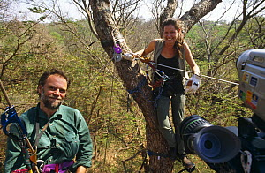 """Presenter Charlotte Uhlenbroek and Assistant Producer Phil Hurrell on zip wire. On location in Madagascar, filming for BBC television series """"Cousins"""", 1999  -  John Waters"""