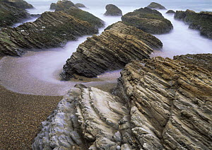 Long exposure of  surging tide on the beach at Spooner's Cove, Montana De Oro State Park, California, USA - Kirkendall-Spring