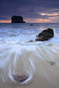 Sea washing off Ballota beach at cloudy sunset, Llanes, Asturias, Spain  -  Jose B. Ruiz