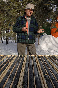 Geologist studying and explaining mineral cores, Northwest Territories, Canada March 2007  -  Eric Baccega