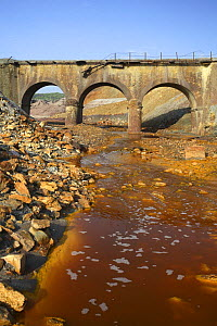 Bridge over the Riotinto river, mineral rich soil mined for iron which seeps into and discolours the river water, Huelva, Spain - Jose B. Ruiz
