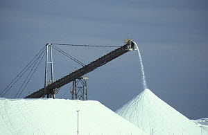 Pyramids of salt at the Leslie Salt Company's operations. Over 2 million tonnes of solar produced salt are exported out of the area each year. Port Hedland, West Australia - Jurgen Freund