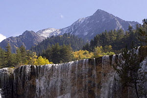 Waterfall with mountains in background, Juizhaigou National Reserve, UNESCO World Heritage Site, Sichuan Province, China, October 06. 'Wild China' series  -  Gavin Maxwell