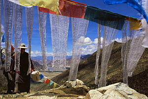 Prayer Flags and people at the Xiongse nunnery, Tibet  2007  -  Gavin Maxwell