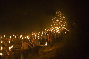 The torchlight procession at the Cotswold Olympicks, a medieval custom and sporting event. Dovers Hill, Gloucestershire, UK  -  Nick Turner