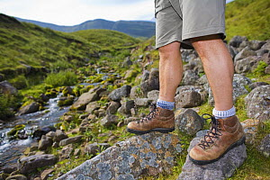 Close-up of walker's legs and walking boots at Llyn y Fan Fach, Brecon Beacons National Park, Powys, Wales - Nick Turner