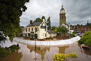 Temporary flood barriers erected around a pub at Upton-on-Severn, Worcestershire, June 2007  -  Nick Turner