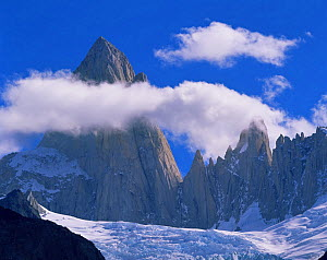 Clouds forming aroung the jagged summit of Mount Fitz Roy (Chalten) over Piedras Blancas glacier, in Glaciers National Park, Argentina - Jack Dykinga