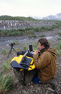 Alastair Fothergill, Producer, at Penguin colony in South Georgia with satellite link-up to BBC NHU in Bristol, UK, January 1998 - Doug Allan