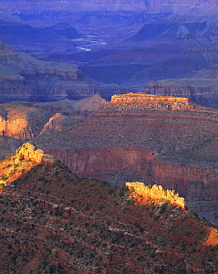 Jagged buttes catch the last light as the sun sets at Grandview Point, Grand Canyon National Park, Arizona  -  Jack Dykinga