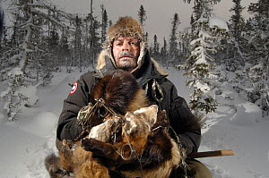Trapper with his catch of one wolverine and four pine martens through the taiga of Manitoba, at -45 degrees C, Canada.  -  Laurent Geslin