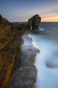Last light of the evening at Pulpit Rock, Portland Bill, Dorset , UK  -  Adam Burton