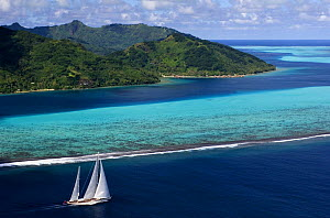 Aerial view of SY ^Adele^, 180 foot Hoek Design, underway close to the reef off Huahine Island, French Polynesia Non editorial uses must be cleared individually.  -  Rick Tomlinson