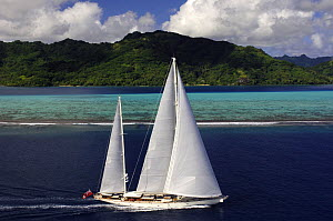 Aerial view of SY ^Adele^, 180 foot Hoek Design, underway close to the reef off Huahine Island, French Polynesia, 2006.  Non editorial uses must be cleared individually.  -  Rick Tomlinson