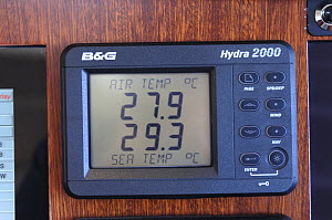 "Digital barometer onboard SY ""Adele"" showing the air and sea temperature whilst sailing in French Polynesia, 2006.  -  Rick Tomlinson"