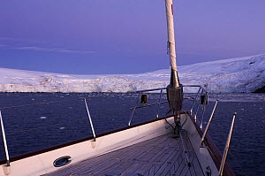 """Evening light on the bow of SY """"Adele"""", 180 foot Hoek Design, in Yankee Harbour, Antarctica, January 2007 Non editorial uses must be cleared individually.  -  Rick Tomlinson"""