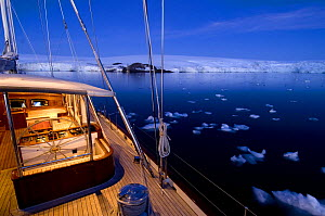 """Evening light on the deck of SY """"Adele"""", 180 foot Hoek Design, in Yankee Harbour, Antarctica, January 2007 Non editorial uses must be cleared individually.  -  Rick Tomlinson"""