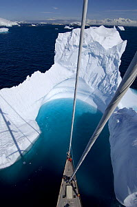 """Aerial view, taken from the mast, of SY """"Adele""""'s bow in the bay of an iceberg, Portal Point, Reclus Pennisula, Antarctica, January 2007 Non editorial uses must be cleared individually. - Rick Tomlinson"""