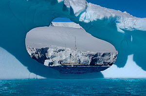 "SY ""Adele"", 180 foot Hoek Design, seen in the distance through an ice window motoring in the Lemair Channel, Antarctica, January 2007 Non editorial uses must be cleared individually.  -  Rick Tomlinson"