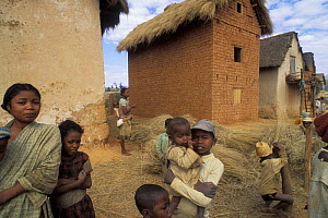 People in Betsileo village with reeds for thatching, Highlands, Madagascar  -  Jouan & Rius