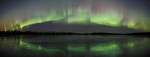 Northern lights, Aurora borealis, arch reflected in water in autumn, Northern Finland 2007  -  Jorma Luhta