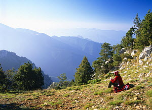 A Hiker resting and admiring the view in Cadi Moixero Natural Park, Spanish Pyrenees  -  Inaki Relanzon