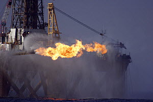 The oil rig J.W McLean flares off gas during drilling operations in the North Sea, September 2006  -  Philip Stephen