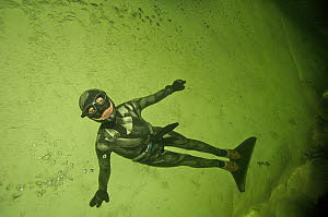 Julia Petrik  free-diving (without air supply) under the ice in the White Sea, Northern Russia March 2008  -  Dan Burton