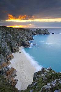 Sunrise at Porthcurno, looking down at the beach from the top of the cliffs, Cornwall, England, UK. Long time exposure - David Noton