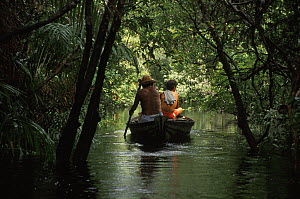 Locals fishing from small boat in flooded Amazon rainforest during rainy season. Rio Tabajos, Brazil 1994 - Michel Roggo