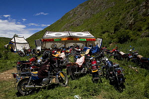 Motorcycles parked at Holy hill near Dargye, Sichuan Province, China, Tibet. Part of the Biodiversity hotspot �Southeast China mountains� - Dr. Axel Gebauer
