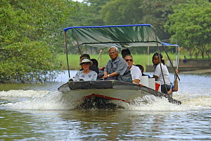 Tourists travelling by boat in Tortuguero National Park, Costa Rica  -  Edwin Giesbers