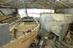 "Shipwrights fairing the hull of Bristol Channel Pilot Cutter ""Morwenna"". RB Boatbuilding, Underfall Yard, Bristol Floating Harbour, England  -  Rob Cousins"