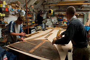 Shipwrights working with templates in Win Cnoops' Slipway Co-operative workshop. Underfall Yard, Bristol Floating Harbour, UK. July 2008, Model Released  -  Rob Cousins
