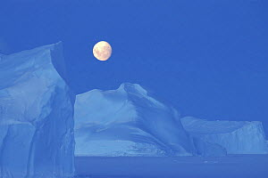 Moon (almost full) rising over antarctic landscape, Antarctica - Fred Olivier