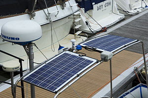 Solar panels on a cabin cruiser, Bristol floating harbour, UK  -  Rob Cousins