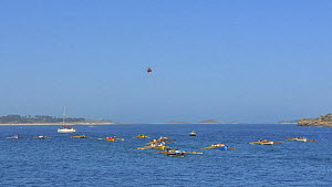 Gig crews rowing out to towards the start line near Tresco for the next heat of the 19th World Pilot Gig Championships, Isles of Scilly, May 2008 - Adam White
