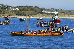 Falmouth Ladies A celebrating their world title by raising their paddles at the 19th World Pilot Gig Championships, Isles of Scilly, May 2008 - Adam White
