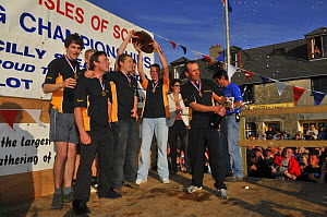Mounts Bay men's crew celebrate their world title on the podium at the awards ceremony of the 19th World Pilot Gig Championships, Isles of Scilly, May 2008  -  Adam White