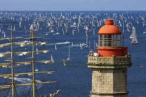 Tall ship passes lighthouse at The Grand Parade at Douarnenez Maritime Festival, France, July 2008  -  Benoit Stichelbaut