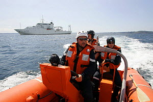 Crew of inflatable lifeboat on exercise, Mer d'Iroise sea, France, August 2005  -  Benoit Stichelbaut