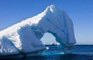 Looking through iceberg arch to the ^Akademik Ioffe^ research ship, Antarctica December 2007 - Adam Burton