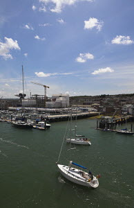 Yacht arriving at Cowes, Isle of Wight, England - Adam Burton