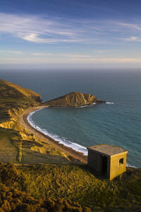 View from Flowers Barrow cliffs of World War Two pillbox lookout and Worbarrow Bay, Jurassic Coast World Heritage Site, Dorset, England  -  Adam Burton